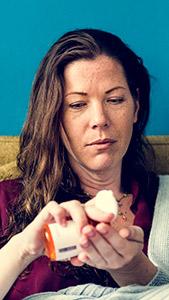A woman taking opioid pills