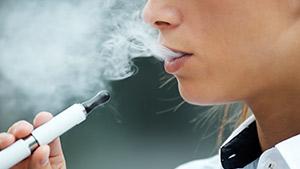 Person smoking an e-cigarette