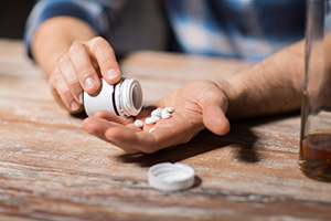 Man pouring Adderall into his hand